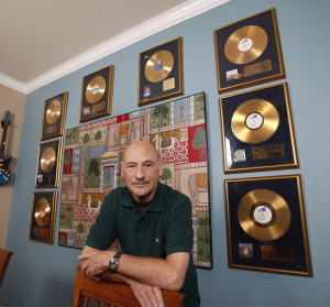 To Our Children's Children's Children's Walls: Pinder at home, surrounded by many of his gold achievements.